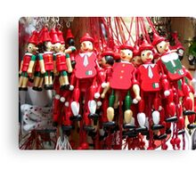 Colourful Red Toy Puppets in Prague Market Square Canvas Print