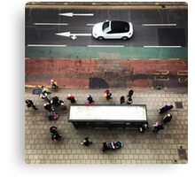 Busy at the bus stop Canvas Print