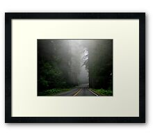 Foggy road through nature's giants, the Redwoods Framed Print