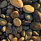 smooth rocks at sunset by Flux Photography