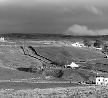 Late afternoon sun with storm following (B & W) by Ian Ker