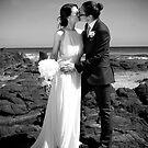 Beachside kiss by AquaMarina