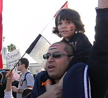 Father and Son Demonstrate Supporting Egypt by Leyla Hur