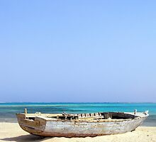 Shipwrecked Wooden Boat on Sandy Beach with Aqua Sky Background by HotHibiscus
