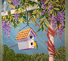 Gold Finch Visiting A Birdhouse Among Lilacs by daphsam