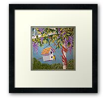 Gold Finch Visiting A Birdhouse Among Lilacs Framed Print