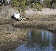 Abandoned boat on water stream by MattawomanImage