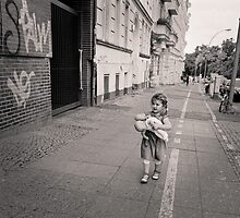 Berlin, Young girl and her doll by Ron Greer