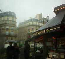 Rainy Day in Paris by Reuben Reynoso