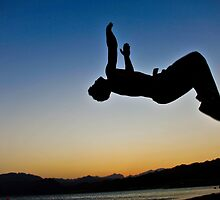 Parkour on the beach at sunset by Chaim  Schvarcz