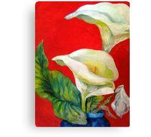 Calla Lilies Against Red Wall Canvas Print