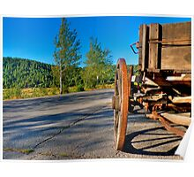 Old wagon on a side of a road Poster