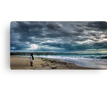 Contemplation - Boy looking out at storm and ocean Canvas Print