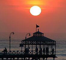 Sunset over Pier, Trujillo, Peru by suellewellyn