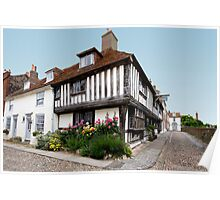 Tudor House with flower bed and cobbled street Poster