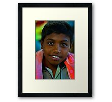 the boy in the market Framed Print