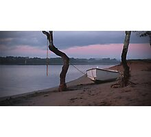dinghy on the sand beside the river Photographic Print