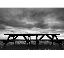 Bench on Beach in black and white. Photographic Print
