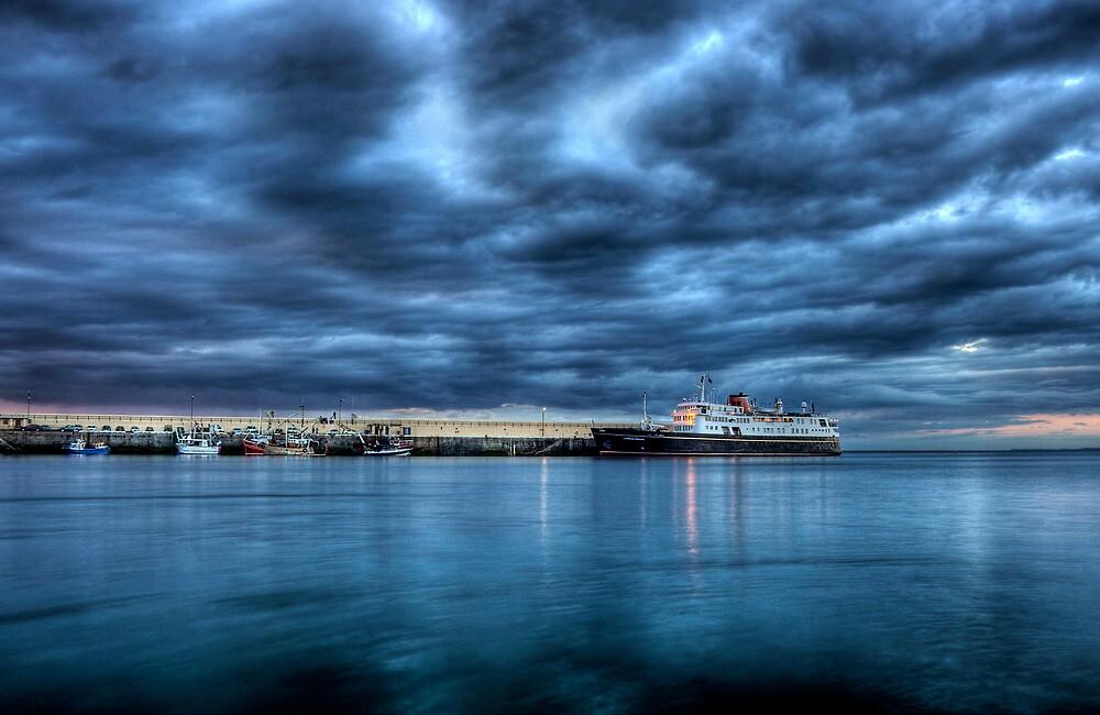 Hebridean Princess in Peel Harbour under a moody sky by RedMann