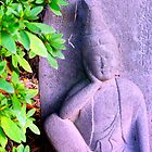 Rock Buddha In Garden by honeyandollie