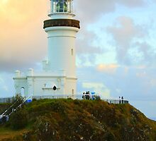 lighthouse with clouds by michelle mcclintock