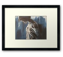 A woman deep in thought Framed Print