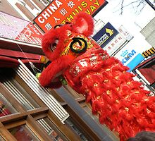 lion dance at door, reaching something :)  by LisaBeth