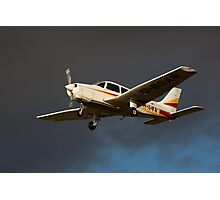 A PA 28 in flight Photographic Print