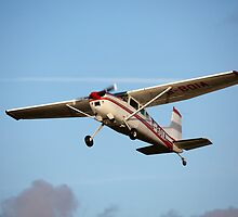 A Cessna 180K in flight by Tony Roddam