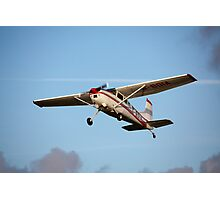 A Cessna 180K in flight Photographic Print