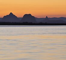 The Glasshouse Mountains at sunset by Meg Forbes