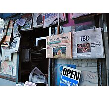 News Source  •  San Fran News Stand Employee Reads Latest News From China Photographic Print