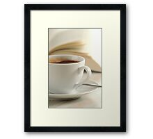 Composition with cup of coffee and book on the table Framed Print