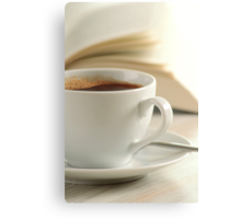 Composition with cup of coffee and book on the table Canvas Print
