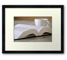 Composition with book and cup of coffee on the table Framed Print