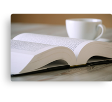 Composition with book and cup of coffee on the table Canvas Print