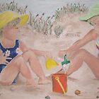 Girls playing in the sand by Jennifer Ingram