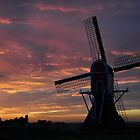 Windmill against the sunset sky by Javimage