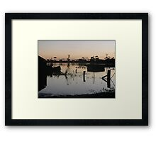 Sun setting on rising waters Framed Print