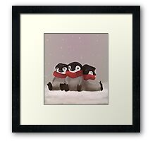 Three little penguins Framed Print
