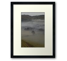 Misty Spire Framed Print