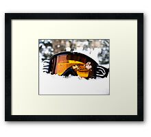 Goggles in the Snow Framed Print