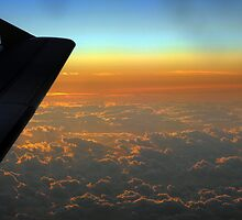 Sunset at 30,000 feet  by larry flewers