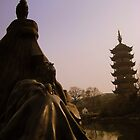 Statue and Buddhist tower in Changzhou, China by Chris Millar