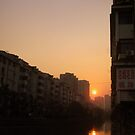 Changzhou housing and river at sunset, China by Chris Millar