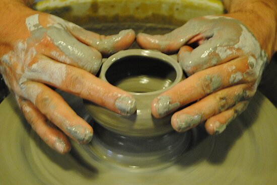 Potter hands, spinning pottery wheel by bethischeery