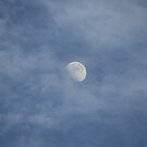 moon shinning thought the clouds by Chris Bastow