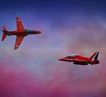 The Red Arrows British Display Team Perform In A Cloud Of Red White And Blue   by miradorpictures