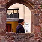 Man in town walks into photograph ..2 by Mike  Waldron
