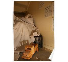 The cupboard under the stairs with small toy truck Poster